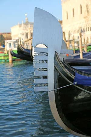 gondolas on the water in venice italy near saint mark square photo