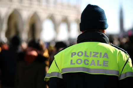 patrol: Italian policeman with police uniform patrol in venice in winter