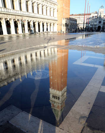st  mark: St Mark Bell Tower at high tide during the flooding of square in Venice Italy