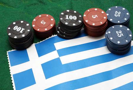 checks: casino checks for gambling over the flag of Greece Stock Photo