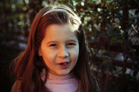 seven year old: portrait of seven year old girl outdoors in winter