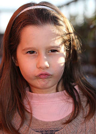 sulk: little European child angry with a wool sweater Stock Photo