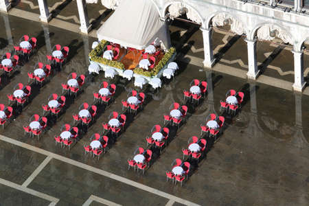 vecchie: outdoor coffee tables and chairs seen from above in Venice Italy Stock Photo