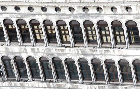 procuratie: many Venetian style Windows in the historic palace in saint Mark Square in Venice Italy