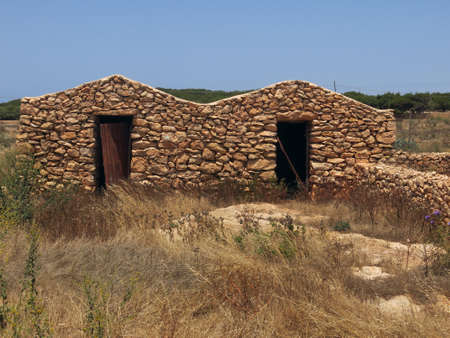 gravel pit: Ancient peasant houses made of stone in Sicily Italy