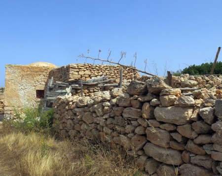 gravel pit: Ancient peasant houses made of stone in Lampedusa Island in Sicily Italy