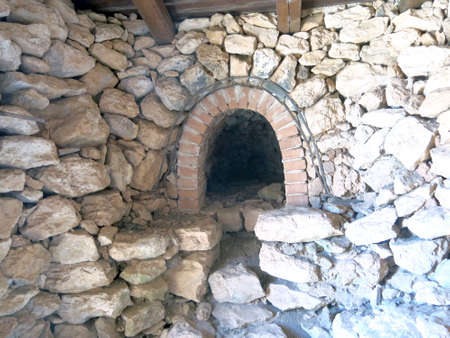 woodburning: old wood-burning oven in an House made of stones and rocks in Sicily Italy