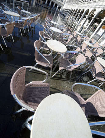 vecchie: Venice, Italy,  Historical Palace called Procuratie Vecchie in Saint Mark Square and the empty chairs of the bar at high tide