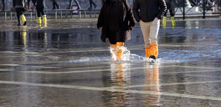 gaiters: venice people with gaiters and boots at high tide in St. Marks square Stock Photo