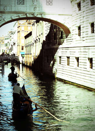 Gondolier on channel of the bridge of sighs in Venice in Italy Banco de Imagens