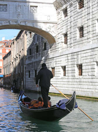 gondolier: Gondolier on channel of the bridge of sighs in Venice in Italy Stock Photo