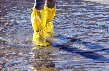 gaiters: venice woman with yellow gaiters at high tide in St. Marks square