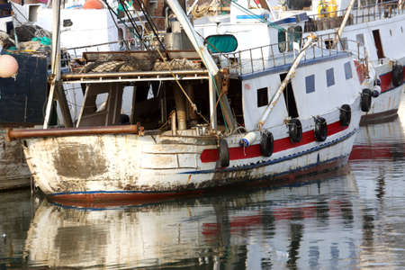 haven: detail of Fishing vessel in sea haven moored in Italy