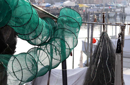 fishing nets: large fishing nets in fishing boat at the pier in italy Stock Photo