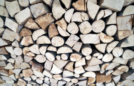 woodshed: large Woodshed with many logs for the wood-burning stove Stock Photo