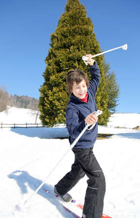 skiing accident: young boy for first time with cross-country skis on fresh snow falls Stock Photo