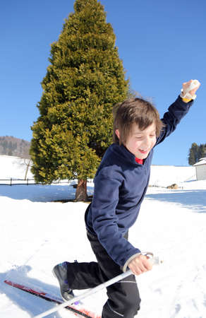 skiing accident: young boy for first time with cross-country skis falls in winter