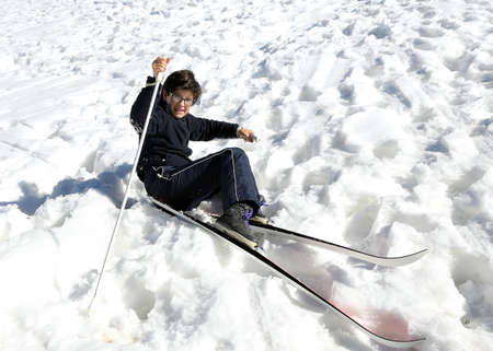 skiing accident: ski school child falls from skis Stock Photo