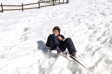 skiing accident: child falls from skiing in winter during a race