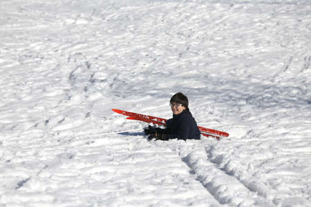 skiing accident: child falls from skiing in winter during a workout Stock Photo