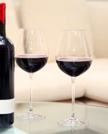 bartenders: two glass goblets glasses with a red wine