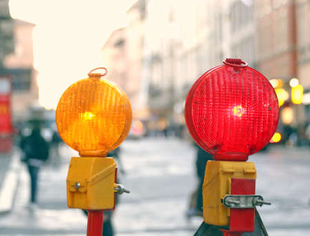 roadworks: yellow lamp and red lamp in roadworks in the city
