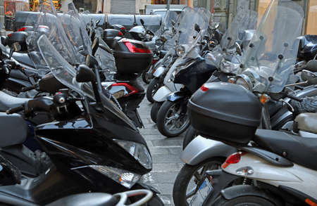 scooters and motorcycles with windshields in winter parked in the european city
