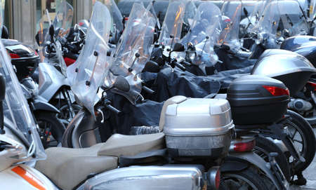 scooters and mopeds with winter windshield parked in the historic city