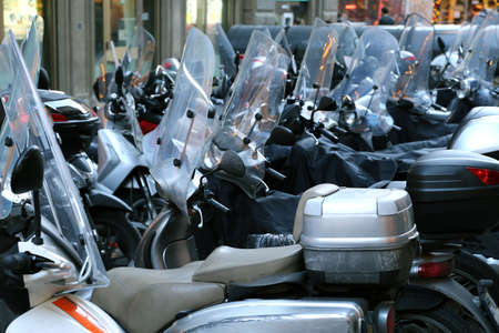 scooters and mopeds with winter windshield parked in the historic center of the city