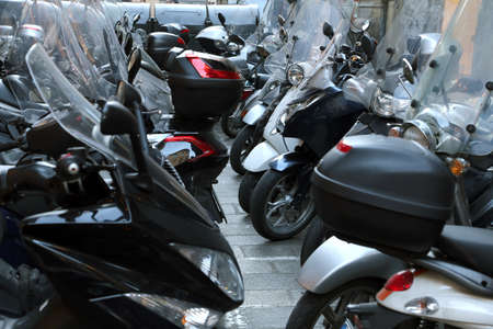 mopeds: scooters and mopeds parked in illegal parking in the city Stock Photo