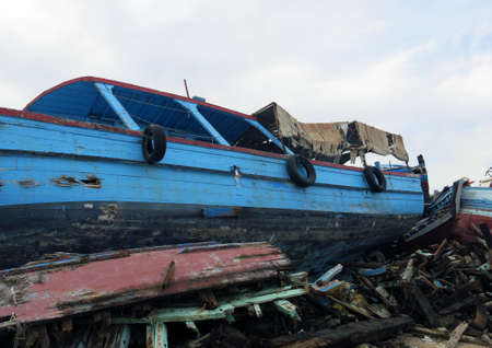 clandestine: broken ancient shipwrecks after the disembarkation of refugees Stock Photo