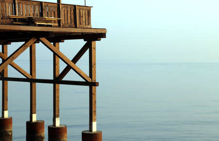 lake dwelling: detail of a big wooden stilt house on the seashore