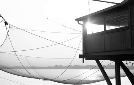 stilt house: large stilt house by the sea and fishing nets of fishermen