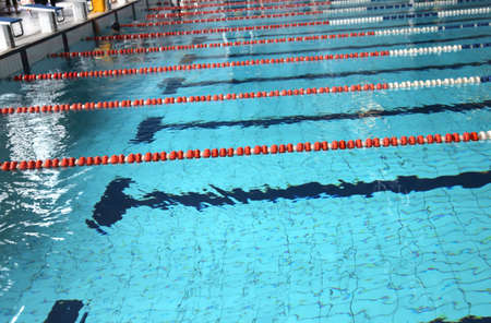 lane marker: indoor swimming pool with blue water and the swimming lanes