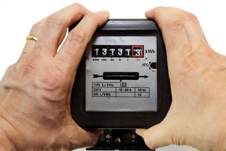metering: two hands shaking with anger the meter of electrical consumption