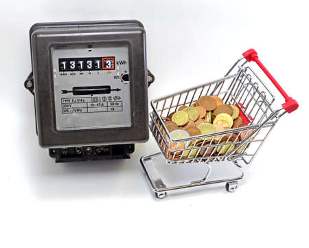 electricity meter: shopping cart full of European currencies and the meter of the family consumption