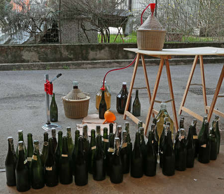 brew house: homemade and very filling glass bottles with an orange funnel