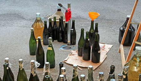 demijohn: homemade and very filling glass bottles with an orange funnel
