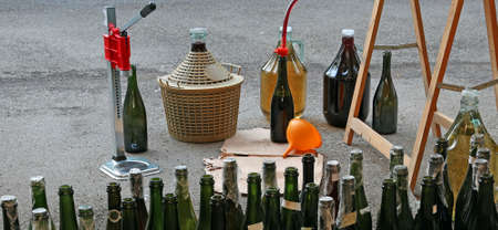 demijohn: pour red wine from the demijohn to glass bottles