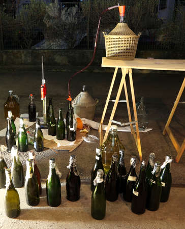 pour the wine in the backyard with the Carboy