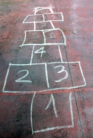 babyhood: ancient game of the staircase with the numbers drawn on the ground with a colored chalk