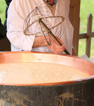 caciocavallo: copper pot with boiling milk for making cheese in the mountain dairy Stock Photo