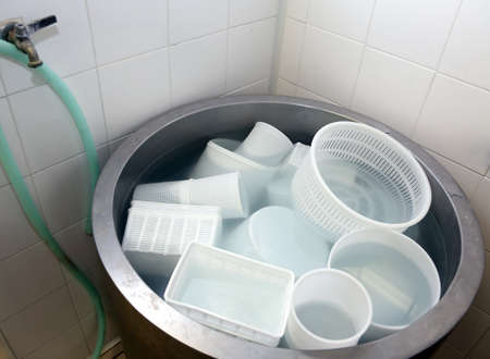 wash tub: dairy containers for making cheese in the wash tub
