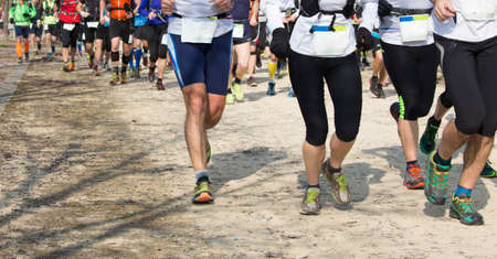 legs around: many athletes run in the outdoor race on the road