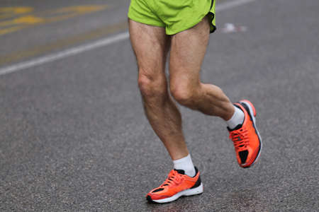 Strong Muscular Legs Of The Athlete During The Road Race With ...