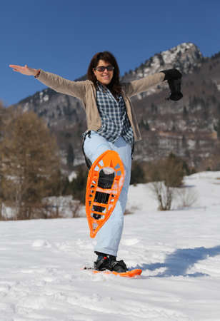 snowshoes: Pretty woman with snowshoes in winter with snow