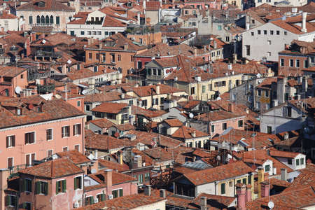population growth: lots of houses with red-tile roofs and bricks in southern Europe