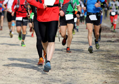 sportingly: many runners in the marathon in the city Stock Photo