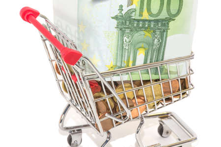 deflation: European moneyand banknotes in the shopping cart Stock Photo