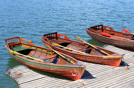 rowboats: three rowboats moored on the shore of little Lake